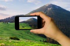 Photo shooting on smartphone. Royalty Free Stock Photo
