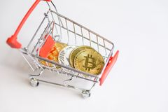 Shopping trolley cart with Coins bitcoin, buying goods for crypto currency. stock images