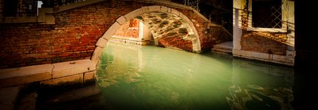 Cristal Clear Water under a Bridge of Venice. Photo shot on the canals of venice stock photography