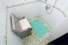 The photo of the shower room with a seat. The photo of the shower room from a tile with a seat stock photo