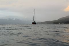 Photo showing a sailboat in the middle of the sea stock photos