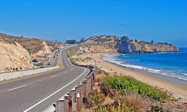 Pacific Coast Highway passing by the El Moro Campground and Crystal Cove Region. Photo shows Coast Highway passing by the El Moro State Park campground (left) stock image