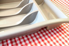 Empty Cutlery Tray. This photo shows an empty cutlery tray on a red gingham background Stock Image