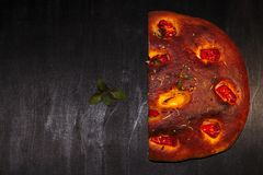 Italian focaccia bread with tomatoes and herbs stock images