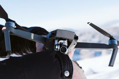 Drone in hand and in the background a mountain range on a sunny day stock photo