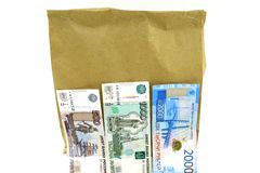 Universal paper bag eco-friendly with three bills on white background stock photography