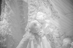 Photo shows part of the beautiful pattern of embroidered wedding dress. For use in wedding royalty free stock photos