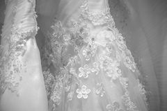 Photo shows part of the beautiful pattern of embroidered wedding dress. For use in wedding stock photos