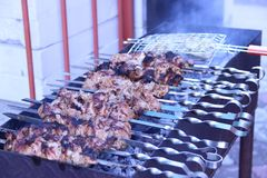 Skewers on the grill. stock photography