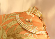 Luxury Pearls. This photo shows some luxurious pearls displayed on a cushion Royalty Free Stock Images