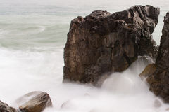 Sea foam. The photo shows the split rock Stock Image