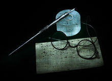 Photo shows Still life with pen, glasses and letter Stock Images