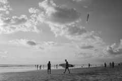 Walking with hold surferboard at Kuta Beach, Bali-Indonesia in the sunset time stock images
