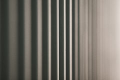 In between. A photo of the side of a large transport container. With the sunlight reflecting of its grey metal surface, the shot is taken with a very narrow royalty free stock image
