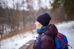 Photo of side view of woman with backpack on blurred background in forest royalty free stock photography