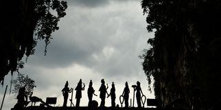 Silhouette of a line of Deities stock photography