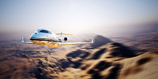 Photo of silver modern and luxury generic design private jet flying in blue sky at sunrise.Uninhabited desert mountains Stock Photos