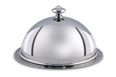 Silver Dome or Cloche isolated with clipping path. Photo of a silver serving dome or Cloche isolated on a white background with clipping path Stock Photography