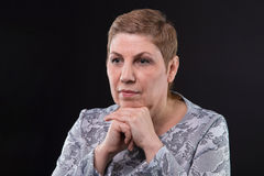Photo of sitting senior woman looking side Royalty Free Stock Image