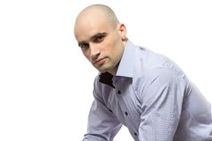 Photo of sitting serious hairless business man Royalty Free Stock Photos