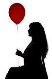 Photo sitting woman with red balloon, profile Royalty Free Stock Photo