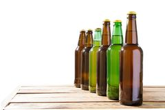 Photo of six different full beer bottles with no labels. Separate clipping path for each bottle included. six 6 separate photos. Merged together. Beer bottles stock photos