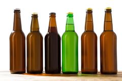 Photo of six different full beer bottles with no labels. Separate clipping path for each bottle included. six 6 separate photos. Merged together. Beer bottles royalty free stock image