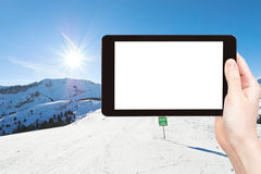Photo of skiing tracks on snow slopes in sunny day Royalty Free Stock Photos