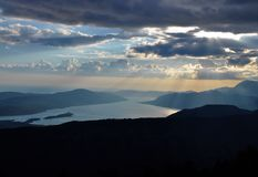 The sky, the clouds, the sun and the mountains in the late afternoon. Photo of the sky with clouds and the Kotor bay in the late afternoon - Kotor Bay royalty free stock photo