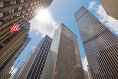 Photo of skyscrapers in Manhattan against the sun. Photo of skyscrapers in Manhattan against the sun, looking up perspective, New York City, USA Royalty Free Stock Photos