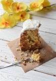 A traditional Easter cake and festive decoration on a white wooden surface Stock Photography