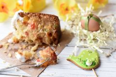 A traditional Easter cake and festive decoration on a white wooden surface Royalty Free Stock Photography