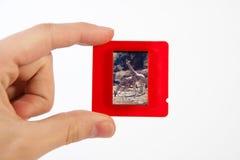 Photo Slide in hand Stock Photos