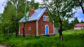 A photo of a small bricky house in Russian Federation Stock Photos