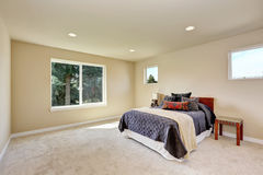 Photo of a small craftsman master bedroom with beige walls. Royalty Free Stock Photography