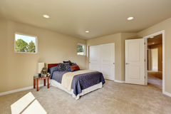 Photo of a small craftsman master bedroom with beige walls. Stock Images