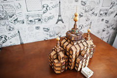 Photo of a small replica of a wooden church on the table. Stock Photos