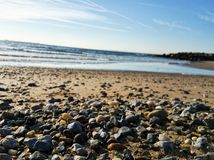Small stones at the Brighton beach captured on a sunny day stock photography