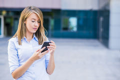 Photo of smart businesswoman calling somebody by mobile telephon Stock Images