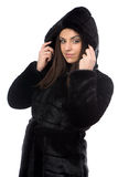 Photo smiling brunette in fake fur coat with hood Stock Photo