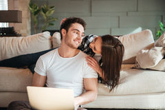 Photo of smiling couple at home Stock Photo