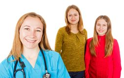 Smiling female doctor and young sisters. Photo of smiling female doctor and young sisters on isolated white background Royalty Free Stock Images