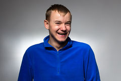 Photo of smiling man in blue pullover royalty free stock image