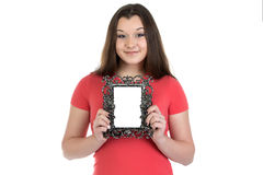 Photo of smiling teenage girl with photo frame. On white background Stock Photography