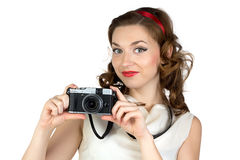 Photo of the smiling woman with camera Royalty Free Stock Images