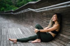 Photo of Smiling Woman Woman in Black Sports Bra and Black Leggings Royalty Free Stock Image