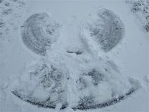 Photo of a snow angel on a path. A photo of a snow angel on a path Royalty Free Stock Images