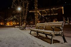 Photo of Snow Covered Benches in the Park Royalty Free Stock Image
