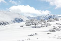 Photo of Snow-covered mountains in Bulgaria. Snow-covered mountains in Bulgaria, Mount Musala, Rila mountain range. Ski resort Borovets Royalty Free Stock Image