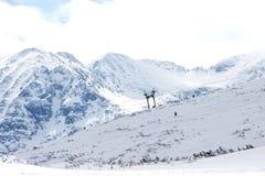 Photo of Snow-covered mountains in Bulgaria. Snow-covered mountains in Bulgaria, Mount Musala, Rila mountain range. Ski resort Borovets Royalty Free Stock Photo